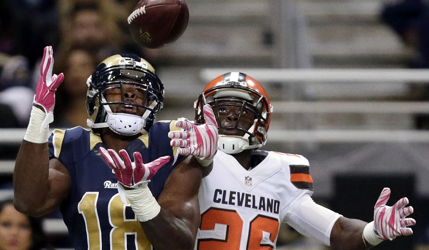 St. Louis Rams wide receiver Kenny Britt, left, catches a 41-yard pass as Cleveland Browns cornerback Pierre Desir defends during the third quarter of an NFL football game Sunday, Oct. 25, 2015, in St. Louis. (AP Photo/Tom Gannam)