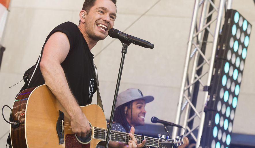 """FILE - In this July 24, 2015 file photo, Andy Grammer performs on NBC's """"Today"""" show at Rockefeller Center in New York. Grammer will perform the national anthem at Game 1 of the World Series on Tuesday, Oct. 27, 2015. (Photo by Charles Sykes/Invision/AP, File)"""