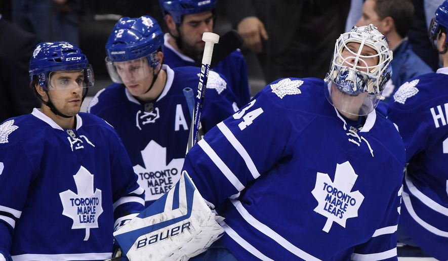 Toronto Maple Leafs goaltender James Reimer skates off the ice following their loss to the Arizona Coyotes in Toronto on Monday, Oct. 26, 2015. (Frank Gunn/The Canadian Press via AP)