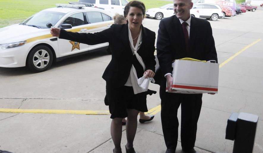 FILE - In this May 22, 2015, file photo, former Republican U.S. Senate candidate Annette Bosworth walks out of the Hughes County Courthouse in Pierre, S.D., with her husband, Chad Haber. Haber, an unsuccessful candidate for attorney general, made his first court appearance Monday, Oct. 26, 2015, in Pierre after being indicted in connection with his wife's problematic 2014 campaign. (AP Photo/ James Nord, File)