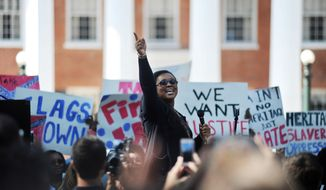 Sunny Fowler speaks during a rally by University of Mississippi students calling on the university to remove the Mississippi state flag from university grounds, in Oxford, Miss., in this Oct. 18, 2015, file photo. (Bruce Newman/The Oxford Eagle via AP, File)