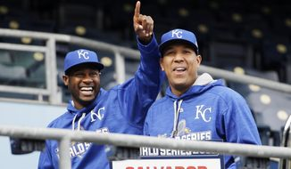 Kansas City Royals' Salvador Perez, right,and Lorenzo Cain walk in the stands at Kauffman Stadium after media day event for the Major League Baseball World Series against the New York Mets Monday, Oct. 26, 2015, in Kansas City, Mo. (AP Photo/David Goldman)