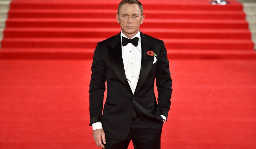 Actor Daniel Craig who, portrays James Bond attends the World Premiere of the new James Bond movie Spectre, held at the Royal Albert Hall in London Monday Oct. 26, 2015.(Matt Crossick/PA via AP) UNITED KINGDOM OUT