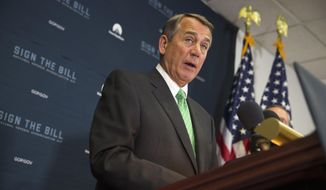 House Speaker John Boehner of Ohio speaks during a news conference on Capitol Hill in Washington, in this Oct. 21, 2015, file photo. Lawmakers are pushing to finalize a sweeping deal to fund the federal government before Boehner leaves Congress at the end of this week. (AP Photo/Evan Vucci, File)