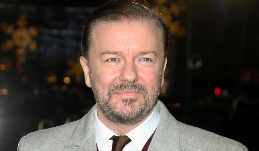 """Actor Ricky Gervais poses for photographers upon arrival for the premiere of the film """"Night at the Museum, Secret of the Tomb"""" in London, Dec. 15, 2014. (Photo by Joel Ryan/Invision/AP) ** FILE **"""