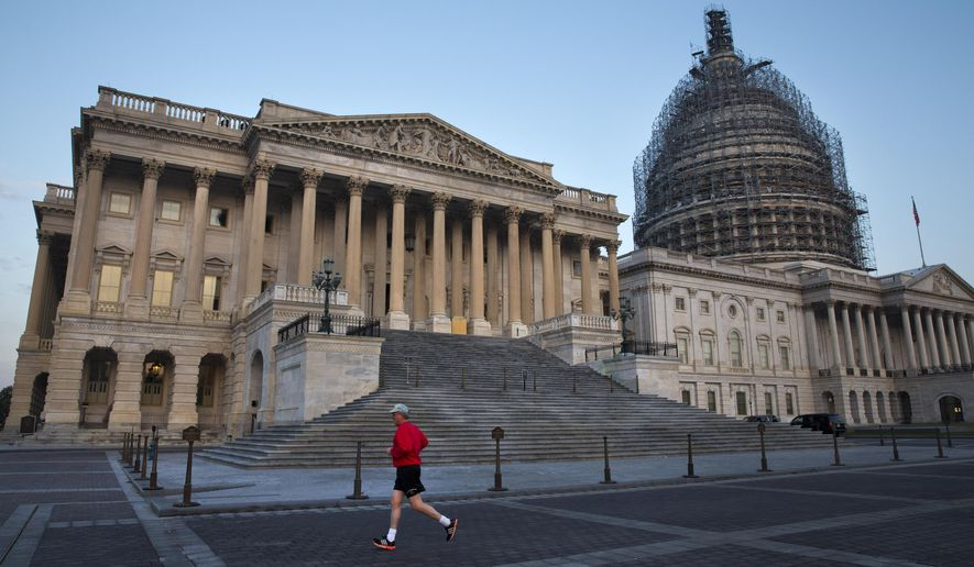 A man jogs past the House side of the Capitol in Washington, Thursday, Oct. 8, 2015. Thursday the House Republican caucus will vote on its nominee to replace House Speaker John Boehner, who is stepping down, and retiring from Congress, at the end of the month, after nearly five years in the role. (AP Photo/Jacquelyn Martin)