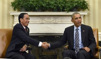 President Barack Obama shake hands with Indonesian President Joko Widodo during their meeting in the Oval Office of the White House in Washington, Monday, Oct. 26, 2015. This is Widodo's first visit to the U,S. since becoming President of Indonesia. (AP Photo/Susan Walsh)