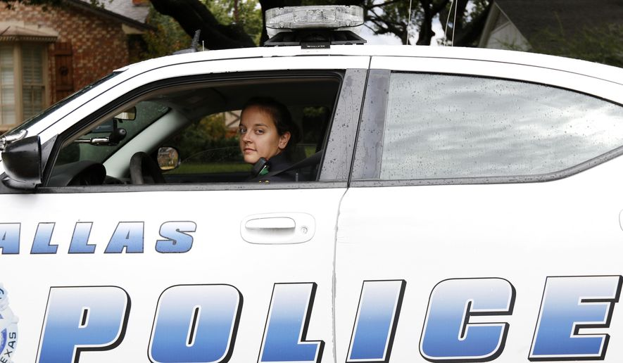In this Oct. 23, 2015, photo, Dallas Police Senior Corporal Stephanie DeTamble poses for a photo in Dallas. DeTamble was not on patrol at the time the photo was taken. Dallas' wealthier neighborhoods increasingly are funding private patrols staffed by off-duty officers. (Rachel Woolf/The Dallas Morning News via AP) MANDATORY CREDIT; MAGS OUT; TV OUT; INTERNET USE BY AP MEMBERS ONLY; NO SALES