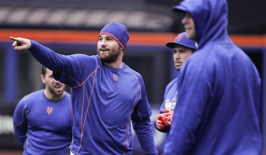 New York Mets second baseman Daniel Murphy, left, talks with teammates during a baseball workout, Saturday, Oct. 24, 2015, in New York. The Mets will face the Kansass City Royals in Game 1 of the World Series on Tuesday in Kansas City. (AP Photo/Julie Jacobson)