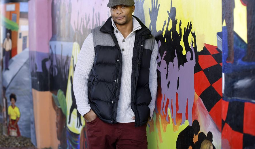 """FILE - In this Jan. 16, 2015, file photo, former Tennessee Titans running back Eddie George poses for photos at an urban improvement project designed and constructed by his landscape and design company, The Edge, in Nashville, Tenn. Former NFL star and Heisman Trophy winner George will make his Broadway debut on Jan. 11, 2016, in the musical """"Chicago,"""" tackling the role of fast-talking lawyer Billy Flynn. (AP Photo/Mark Humphrey, File)"""