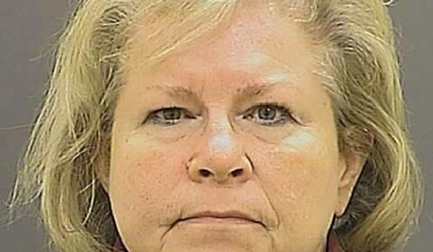 FILE - This undated file photo provided by the Baltimore Police Department shows former Episcopal Bishop Heather Cook. Cook, who killed a bicyclist in Baltimore while driving drunk was sentenced Tuesday, Oct. 27, 2015, to seven years in prison. (Baltimore Police Department via AP, File)