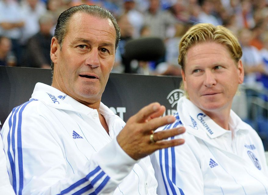 FILE - In this Sept. 29, 2011 file picture then Schalke's head coach Trainer Huub Stevens , left, and  then assistant coach Markus Gisdol talk prior to the Europa League group J soccer match between FC Schalke 04 and Maccabi Haifa  in Gelsenkirchen, Germany.  Hoffenheim has sacked coach Markus Gisdol and named veteran Huub Stevens as his successor, with the 61-year-old signing a contract until the end of the season Monday Oct. 26, 2015. Hoffenheim, which lost 1-0 at home to Hamburger SV on Friday, has dropped to next-to-last in the Bundesliga, with six points from the first 10 matches.  ( Marius Becker/dpa via AP)