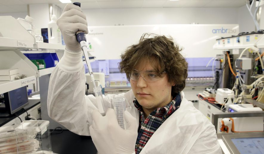 FILE - In this Thursday, Dec. 18, 2014 file photo, scientist William Napoli draws a substance for an experiment in a laboratory at the Merck company facilities in Kenilworth, N.J. Merck reports quarterly financial results on Tuesday, Oct. 27, 2015. (AP Photo/Mel Evans, File)