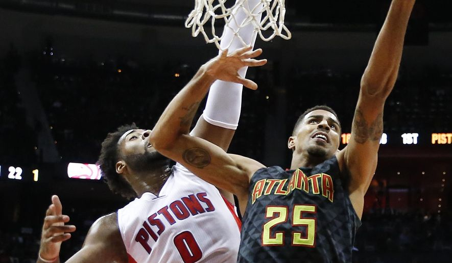 Atlanta Hawks guard Thabo Sefolosha (25) goes up for a basket against Detroit Pistons center Andre Drummond (0) during the first half of an NBA basketball game Tuesday, Oct. 27, 2015, in Atlanta. (AP Photo/ John Bazemore)