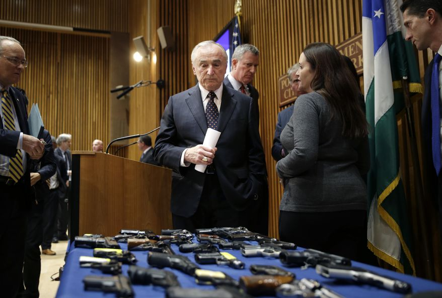 New York City Police Commissioner William Bratton looks at a display of seized guns as he leaves a news conference in New York, Tuesday, Oct. 27, 2015. Officials announced charges in a gun trafficking case where more than 70 firearms were seized. (AP Photo/Seth Wenig) ** FILE **