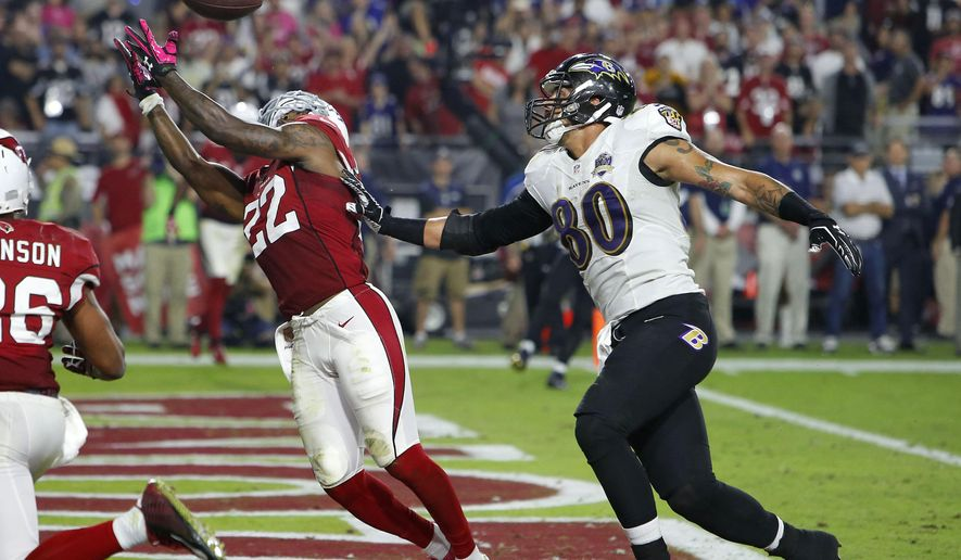 Arizona Cardinals strong safety Tony Jefferson (22) intercepts a  throw intended for Baltimore Ravens tight end Crockett Gillmore (80) in the end zone during the final seconds the second half of an NFL football game, Monday, Oct. 26, 2015, in Glendale, Ariz. The Cardinals won 26-18. (AP Photo/Rick Scuteri)