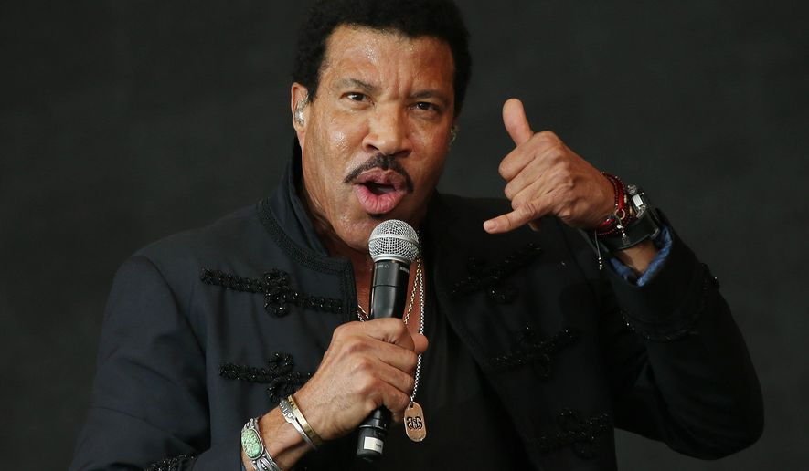 FILE - In this June 28, 2015, file photo, Lionel Richie performs on the Pyramid stage at Glastonbury music festival on Worthy Farm, Glastonbury, England. Stevie Wonder, Usher, Lenny Kravitz and Demi Lovato will honor Richie when he is named MusiCares person of the year next year. The Recording Academy said on Tuesday, Oct. 27, 2015, that John Legend, The Roots and Zac Brown will also pay tribute to Richie at the Feb. 13, 2016, event in Los Angeles. (Photo by Joel Ryan/Invision/AP, File)