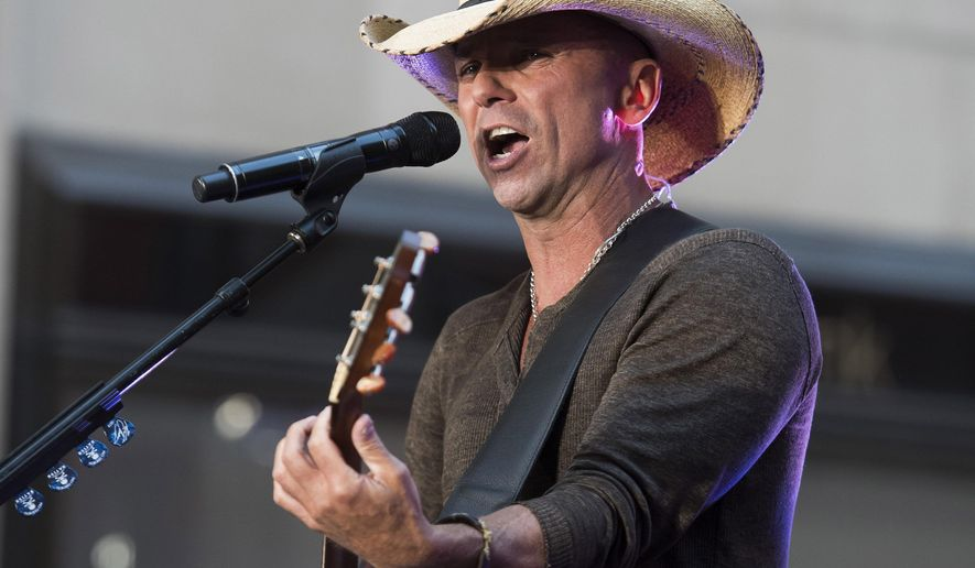 """FILE - In this Tuesday, Sept. 23, 2014, file photo, Kenny Chesney performs on NBC's """"Today"""" show in New York. Chesney announced Tuesday, Oct. 27, 2015, he'll be returning to Pittsburgh for the second time since a 2013 concert that drew national attention for the disorderly behavior of fans. Chesney will be performing with Miranda Lambert and Sam Hunt at Heinz Field on July 2. (Photo by Charles Sykes/Invision/AP, File)"""