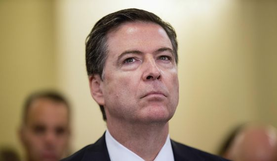 FBI Director James Comey listens while testifying on Capitol Hill in Washington, in this Oct. 21, 2015, file photo. (AP Photo/Andrew Harnik, File) ** FILE **