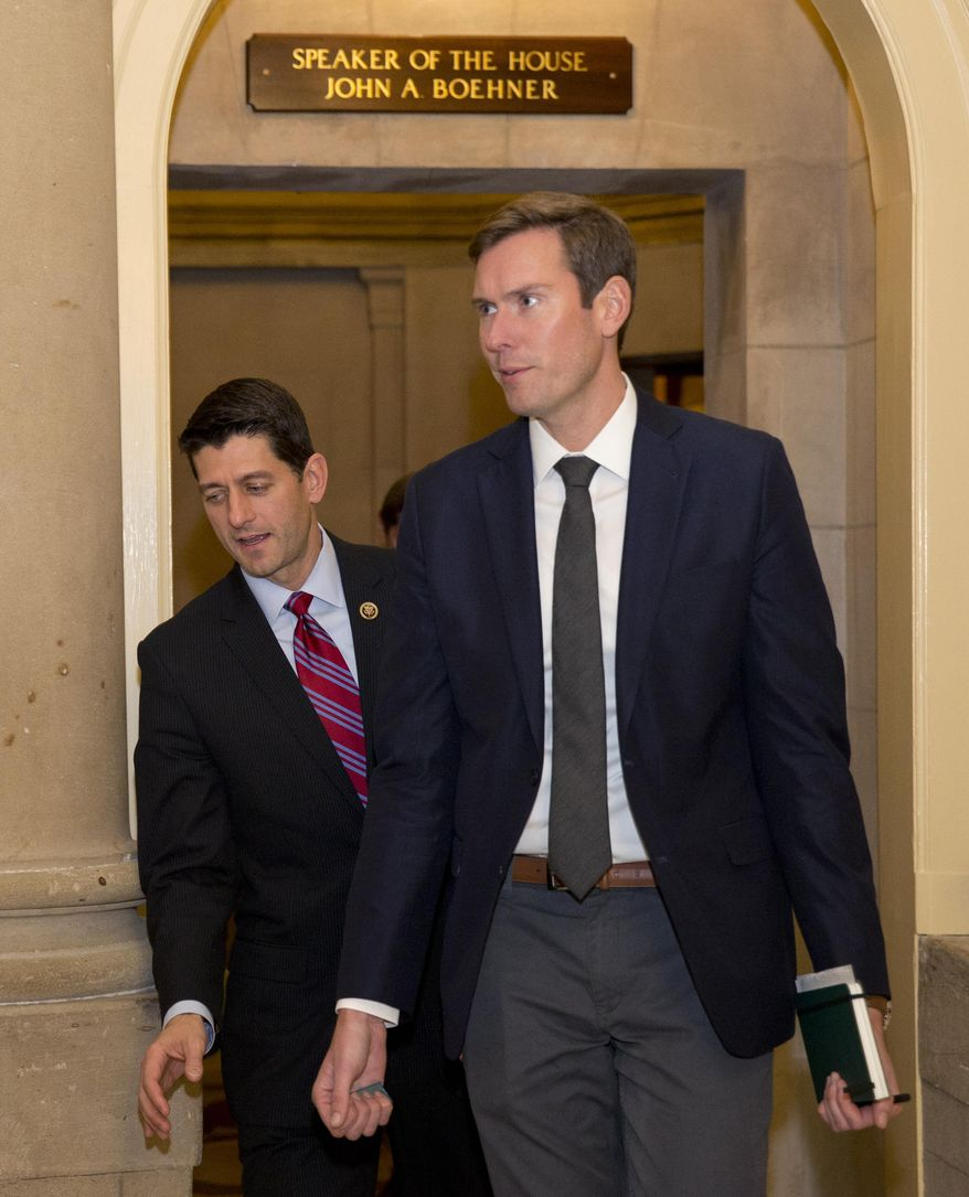 Rep. Paul Ryan, left, walks from a hallway near House Speaker John Boehner of Ohio's office on Capitol Hill in Washington, Monday, Oct. 26, 2015. Speaker John Boehner is pressing ahead with one last deal as he heads for the exits, pushing to finalize a far-reaching, two-year budget agreement with President Barack Obama before handing Congress' top job over to Ryan this week, congressional officials said Monday.(AP Photo/Carolyn Kaster)