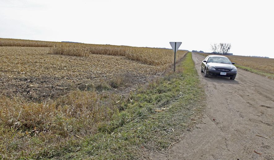 A car blocks an area near where a body was found, Tuesday, Oct. 27, 2015, in Douglas County, Minn. The body found in a farm field in west-central Minnesota is likely that of a missing college student, sheriff's officials said Tuesday. (Elizabeth Flores/Star Tribune via AP)  MANDATORY CREDIT; ST. PAUL PIONEER PRESS OUT; MAGS OUT; TWIN CITIES LOCAL TELEVISION OUT