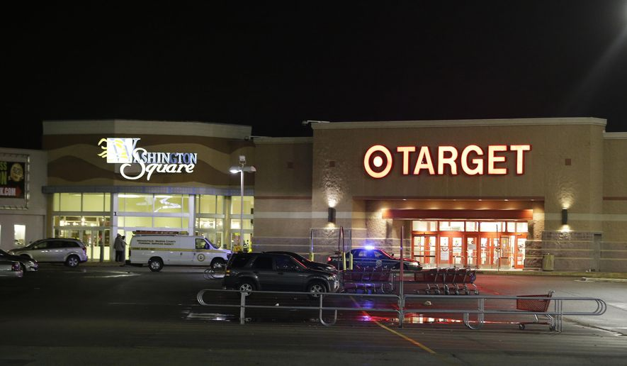 Police stand outside of the entrance at the Washington Square Mall on Wednesday, Oct. 28, 2015, in Indianapolis. Indianapolis police responded to a report of multiple people shot at the shopping mall. (AP Photo/Darron Cummings)