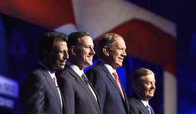 Republican presidential candidates, from left, Bobby Jindal, Rick Santorum, George Pataki, and Lindsey Graham take the stage during the CNBC Republican presidential debate at the University of Colorado, Wednesday, Oct. 28, 2015, in Boulder, Colo. (AP Photo/Mark J. Terrill)