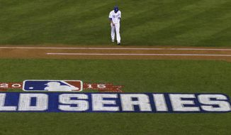 Kansas City Royals pitcher Edinson Volquez walks back to the dugout during Game 1 of the Major League Baseball World Series against the New York Mets Tuesday, Oct. 27, 2015, in Kansas City, Mo. (AP Photo/David J. Phillip)