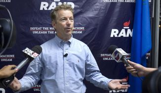Republican presidential candidate Sen. Rand Paul, R-Ky., speaks with the media during the opening of a Rand Paul campaign office in Las Vegas, Monday, Oct. 26, 2015. (Steve Marcus/Las Vegas Sun via AP)  ** FILE **
