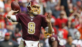 Washington Redskins quarterback Kirk Cousins (8) passes the ball during the first half of an NFL football game against the Tampa Bay Buccaneers in Landover, Md., Sunday, Oct. 25, 2015. (AP Photo/Patrick Semansky)