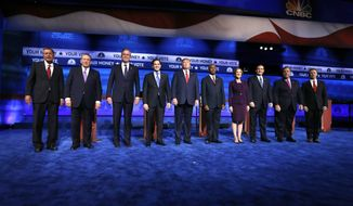 Republican presidential candidates (from left) John Kasich, Mike Huckabee, Jeb Bush, Marco Rubio, Donald Trump, Ben Carson, Carly Fiorina, Ted Cruz, Chris Christie and Rand Paul take the stage during the CNBC Republican presidential debate at the University of Colorado on Wednesday. (Associated Press)