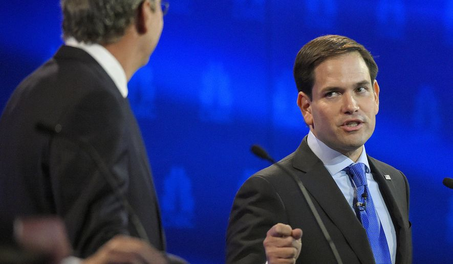Marco Rubio and Jeb Bush, argue a point during the CNBC Republican presidential debate at the University of Colorado on Wednesday in Boulder, Colo. (Associated Press)