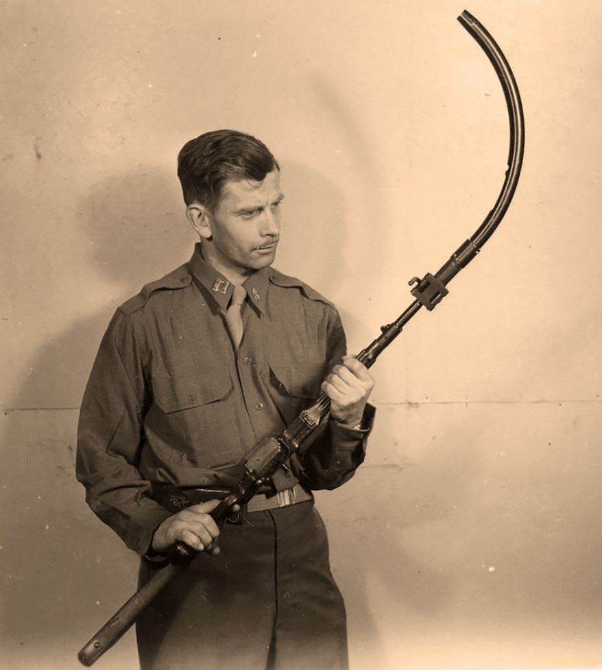 """The Krummlauf  or """"curved barrel"""" is a bent barrel attachment for the Sturmgewehr 44 assault rifle developed by Germany in World War II. The curved barrel included a periscope sighting device for shooting around corners from a safe position. It was produced in several variants: an """"I"""" version for infantry use, a """"P"""" version for use in tanks (to cover the dead areas in the close range around the tank, to defend against assaulting infantry), versions with 30°, 45°, 60° and 90° bends, a version for the StG 44 and one for the MG 42. Only the 30° """"I"""" version for the StG 44 was produced in any numbers. The bent barrel attachments had very short lifespans  approx. 300 rounds for the 30° version, and 160 rounds for the 45° variantas the barrel and bullets fired were put under great stress. Another problem besides the short life-span was that the bending caused the bullets to shatter and exit the barrel in multiple fragments, producing an unintended shotgun effect. As a result, weapons designers experimented with small vent holes drilled into the Krummlauf's barrel in order to reduce pressure and recoil, allowing the discharged bullets' built-up gases to be released to slow the bullet's velocity as it turned to exit the barrel. Nevertheless, the Krummlauf's lifespan remained the same."""