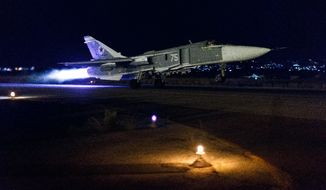 A Russian Su-24 bomber takes off on a night combat mission in Syria. (Russian Defense Ministry Press Service via Associated Press)