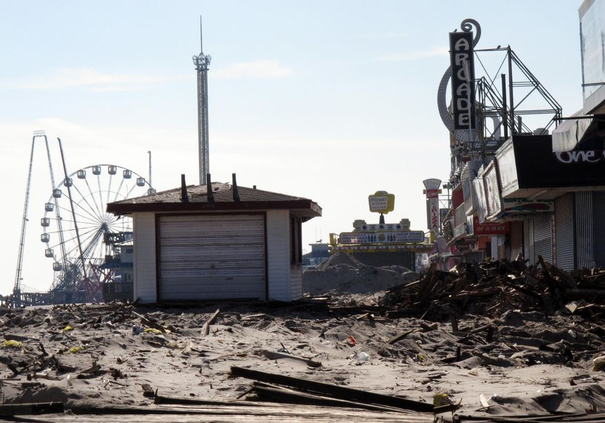 In this Nov. 29, 2012, file photo, taken about a month after Superstorm Sandy hit, shows the Seaside Heights, N.J., boardwalk in ruins from storm damage. Three years after the storm, virtually all the boardwalks in New Jersey and New York have been rebuilt, with one remaining to be finished in each state. (AP Photo/Wayne Parry, File)
