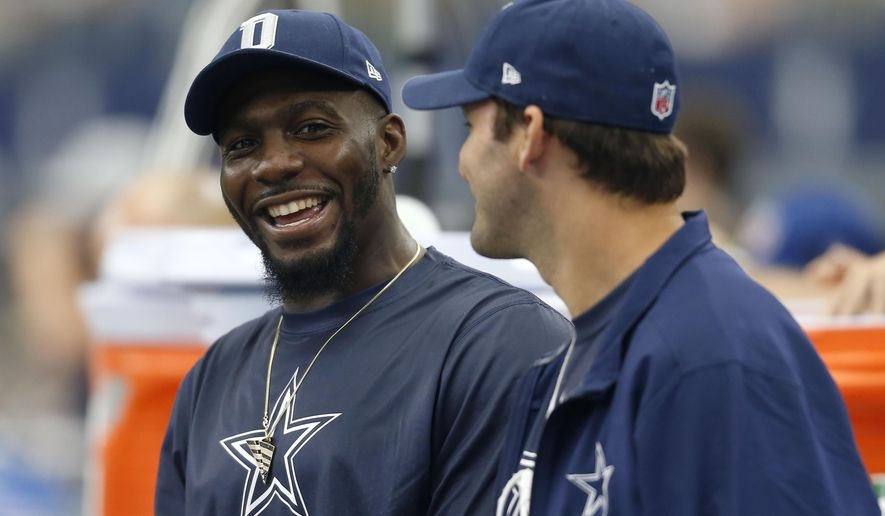 FILE - In this Sept. 27, 2015, file photo, Dallas Cowboys' Dez Bryant, left, and Tony Romo, right, talk on the sideline in the first half of an NFL football game against the Atlanta Falcons in Arlington, Texas. Bryant is returning to practice for the first time in almost seven weeks, boosting the prospects of Dallas\ All-Pro receiver returning from a broken foot against Seattle this week. (AP Photo/Brandon Wade, File)