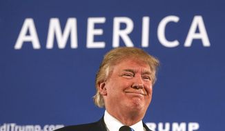Republican presidential candidate Donald Trump smiles as he receives applause after speaking at a town hall meeting at Atkinson Country Club in Atkinson, N.H., in this Oct. 26, 2015, file photo. (AP Photo/Cheryl Senter) ** FILE **