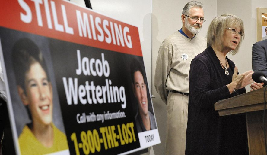 """In this Oct. 14, 2014 file photo, Patty, right, and Jerry Wetterling take part in a news conference at the Stearns County Law Enforcement Center in St. Cloud, Minn., to announce the installation of six new billboards that will be placed near where their son Jacob was abducted in 1989. Federal authorities said Thursday, Oct. 29, 2015, Daniel James Heinrich, a Minnesota man charged with child pornography after a search of his home found pictures of naked boys is also a """"person of interest"""" in the disappearance of Jacob Wetterling, whose 1989 abduction led his parents to launch a national center to prevent child exploitation.  (Dave Schwarz/St. Cloud Times via AP, File)"""