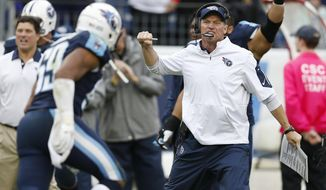 Tennessee Titans head coach Ken Whisenhunt celebrates after the Titans intercepted a pass in the end zone against the Atlanta Falcons in the second half of an NFL football game Sunday, Oct. 25, 2015, in Nashville, Tenn. (AP Photo/Weston Kenney)