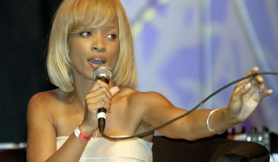 "FILE - In this July 3, 2006 file photo, actress Karrine Steffans discusses the role of women and how they are portrayed in music videos during a seminar at the Essence Music Festival in Houston. The author of the 2005 bestseller ""Confessions of a Video Vixen,"" who published a sequel in June entitled ""Vindicated: Confessions of a Video Vixen, Ten Years Later,"" says she's in a healthy, happy relationship and finally comfortable in her skin.  (AP Photo/Tim Johnson, File)"