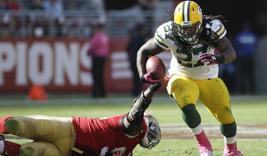 FILE - In this Oct. 4, 2015, file photo, Green Bay Packers running back Eddie Lacy (27) runs against the San Francisco 49ers during the second half of an NFL football game in Santa Clara, Calif. With James Starks slowed down by a hip injury, Lacy may have more chances to firmly establish himself once again as the top option in the Packers backfield. (AP Photo/Marcio Jose Sanchez, File)