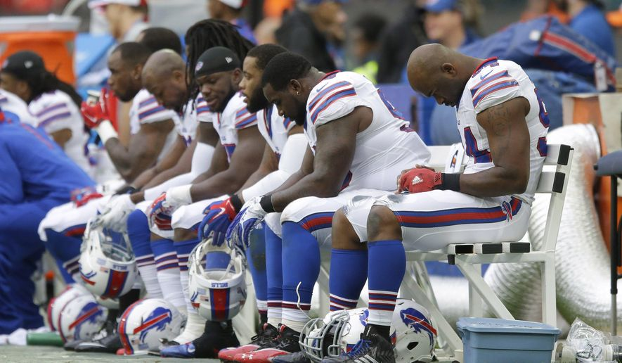 The Buffalo Bills defensive line look down as they sit on the bench during the NFL game between Buffalo Bills and Jacksonville Jaguars at Wembley Stadium in London,  Sunday, Oct. 25, 2015. (AP Photo/Matt Dunham)