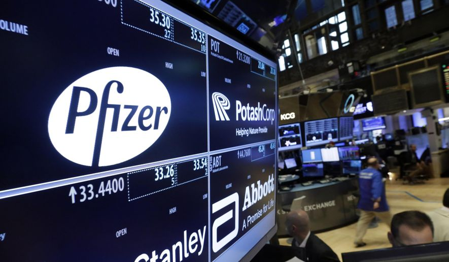 The logo for Pfizer is displayed on a trading post on the floor of the New York Stock Exchange, Thursday, Oct. 29, 2015. (AP Photo/Richard Drew) ** FILE **
