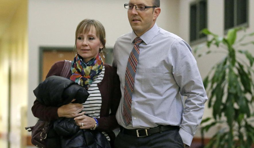Zac and Hilary Cheney,  parents of a 4-year-old Utah boy who was crushed by a tombstone, arrive for court Thursday, Oct. 29, 2015, in Park City, Utah. Lawyers for the family say he died after shoddy maintenance left a historic headstone weak and dangerous. (AP Photo/Rick Bowmer)