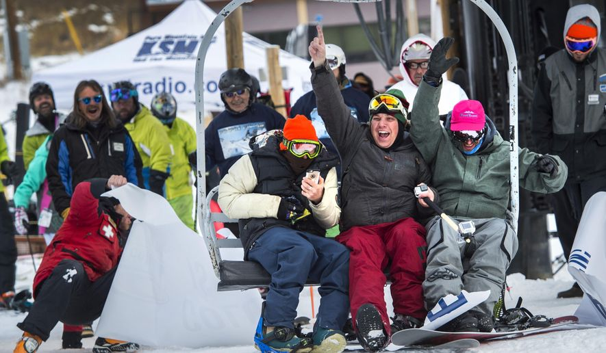 """""""Nickademus Mantooth,"""" left, """"Trailor Tom"""" and Nate """"Dogggg"""" Nalder ride the first chair at Loveland Ski Area in Colo., Thursday, Oct. 29, 2015, on the opening day of the 2015-16 ski season. Loveland and Arapahoe Basin Ski Area opened Thursday. Nalder has been on the first chair in Colorado for the past 20 years. (Christian Murdock/The Gazette via AP) MAGS OUT; MANDATORY CREDIT"""