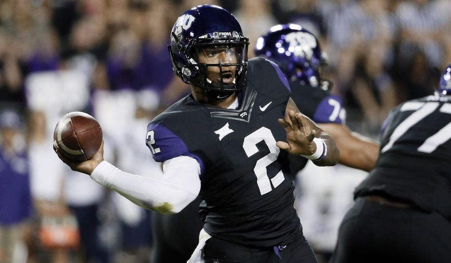 TCU quarterback Trevone Boykin (2) passes in the first half of an NCAA college football game against West Virginia Thursday, Oct. 29, 2015, in Fort Worth, Texas. (AP Photo/Tony Gutierrez)