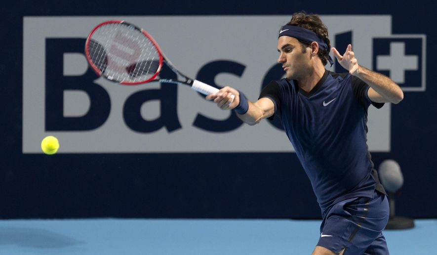 Switzerland's Roger Federer returns a ball to Germany's Philipp Kohlschreiber during their match at the Swiss Indoors tennis tournament at the St. Jakobshalle in Basel, Switzerland, on Thursday, Oct. 29, 2015. (Georgios Kefalas/Keystone via AP)