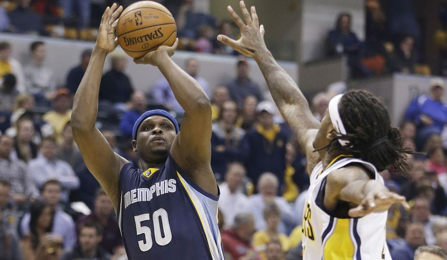 Memphis Grizzlies' Zach Randolph, left, shoots against Indiana Pacers' Jordan Hill, right, during the first half of an NBA basketball game Thursday, Oct. 29, 2015, in Indianapolis. (AP Photo/Darron Cummings)