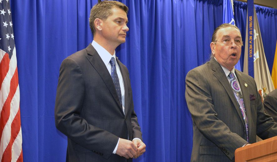 U.S. Attorney Damon Martinez, left, and Indian Arts and Crafts Board chairman Harvey Pratt take questions about a long federal investigation into the selling of fake American Indian jewelry during a news conference in Albuquerque, N.M. on Thursday, Oct. 29, 2015. Federal authorities announced Thursday that three New Mexico residents have been indicted in a scam to sell Filipino-made jewelry as American Indian made. (AP Photo/Russell Contreras)