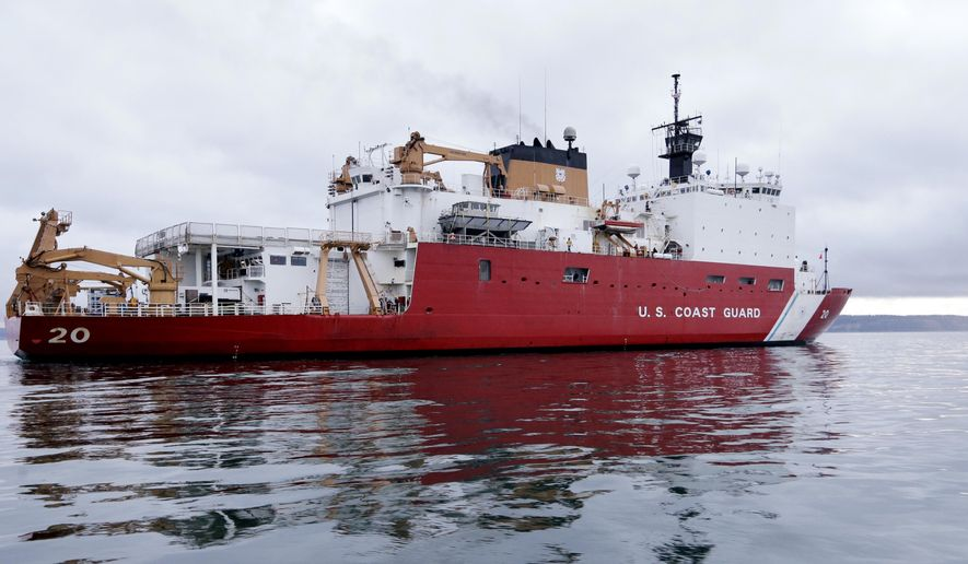 The U.S. Coast Guard Cutter Healy makes its way through the Puget Sound Thursday, Oct. 29, 2015, on its way to their homeport of Seattle. The 420-foot polar icebreaker, the country's newest high-latitude vessel, returned to Seattle after cutting its way to the North Pole in support of a mission to study the health of the Arctic Ocean. The ship is capable of breaking more than 10 feet of ice. (AP Photo/Elaine Thompson)